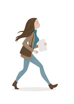 Jovem mulher com cabelos castanhos em um azul trouses e casaco marrom com um saco. moça caminhando.