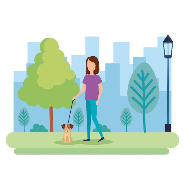 Jovem mulher com cachorro no parque