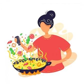 Jovem mulher coocking macarrão na frigideira wok.