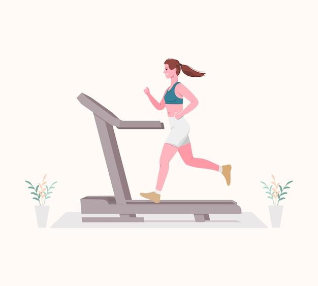 Jovem mulher correndo em uma esteira. conceito de esporte indoor.