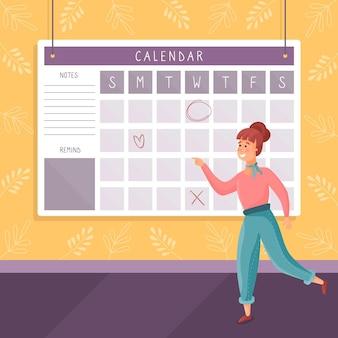 Jovem mulher fazendo uma reserva de compromisso em um calendário