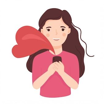 Jovem mulher feliz, segurando o telefone com símbolo de amor