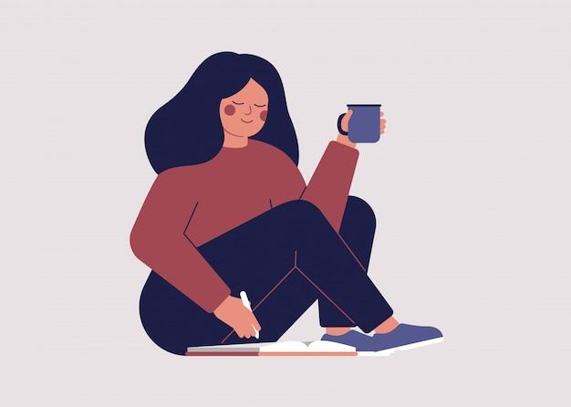 Jovem mulher lê sua agenda pela manhã e planeja seu dia.
