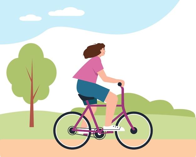 Jovem mulher na bicicleta no parque. menina feliz sorridente andando de bicicleta atividade ao ar livre