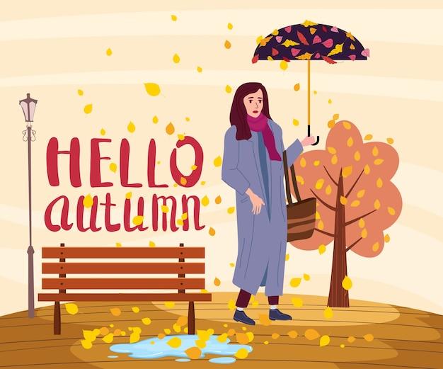 Jovem mulher na cidade de parque outono com guarda-chuva, roupas da moda, estilo elegante de rua outwear feminino, humor de outono. letras olá outono