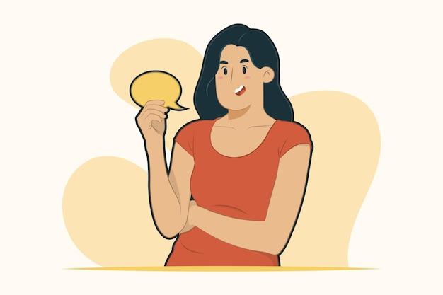 Jovem mulher segurando um balão de fala e um conceito de conversa fiada