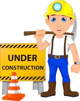 Jovem operário com sinal de construção