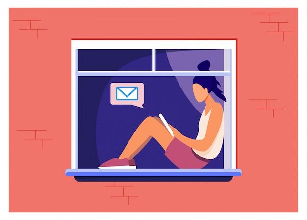 Jovem sentada na janela com um tablet