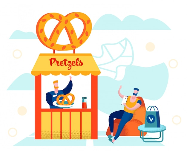 Jovem sentado com smartphone na tenda de pretzel
