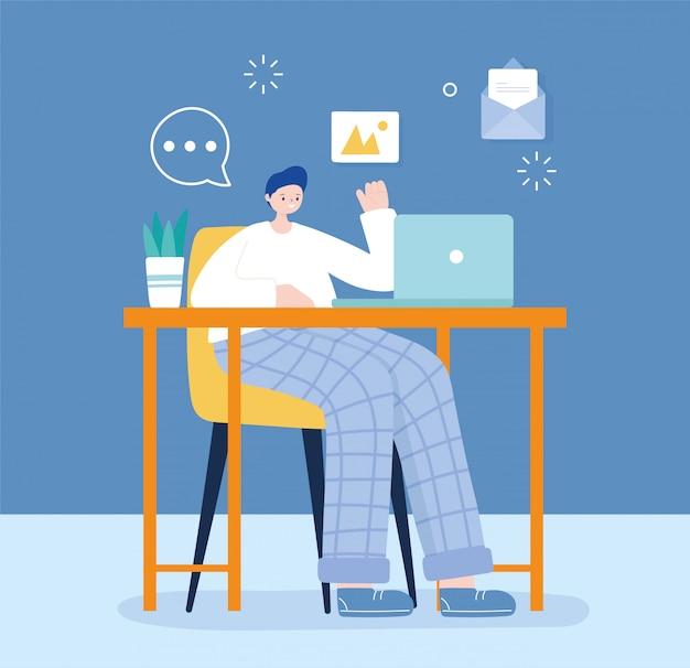 Jovem sentado na cadeira, usando mensagens de texto de laptop conversando com mídias sociais