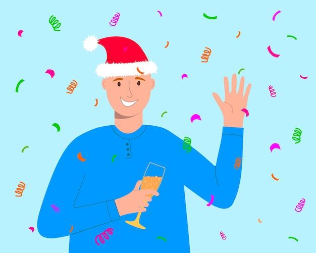 Jovem sorridente com chapéu de papai noel segurando uma taça com champanhe e celebrando o natal ou ano novo