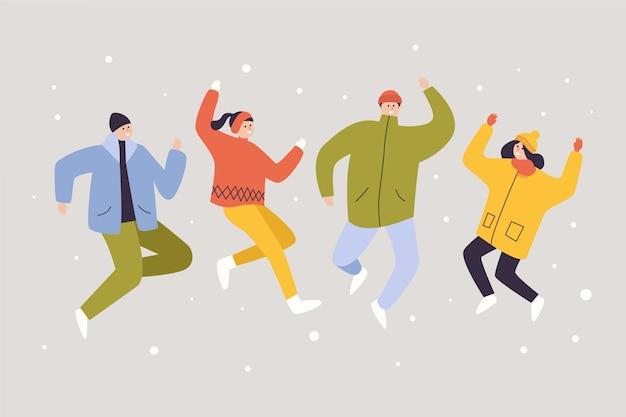 Jovens em roupas de inverno pulando
