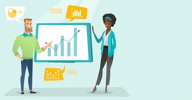 Jovens empresários apresentando dados financeiros.