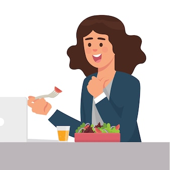 Jovens trabalhadores almoçam alegremente com uma caixa de saladas