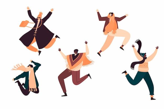 Jovens vestindo roupas de inverno pulando conjunto