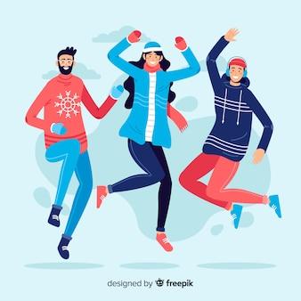Jovens vestindo roupas de inverno pulando pacote