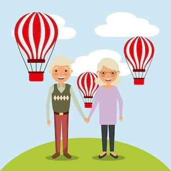 Junte a velha e os avós do homem com balões de ar voando céu