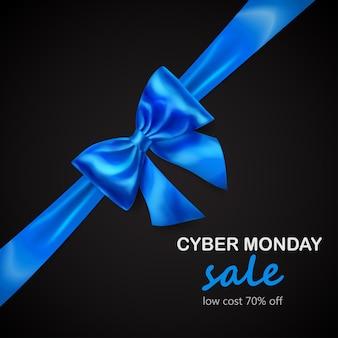 Laço azul com fita na diagonal com sombra e inscrição venda de cyber segunda-feira em fundo preto