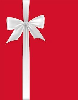 Laço branco e fita de cetim sobre um fundo vermelho.
