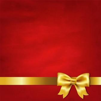 Laço de cetim dourado e fundo vintage vermelho