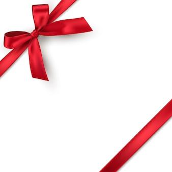Laço de presente realista vermelho com fita isolada no fundo branco.