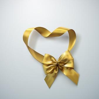 Laço dourado e fita coração