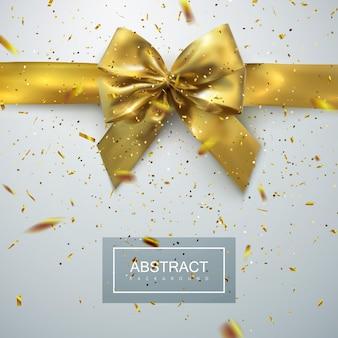 Laço e fita dourados com confetes cintilantes