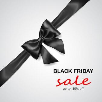 Laço preto com fita na diagonal com sombra e inscrição venda de sexta-feira negra em fundo cinza