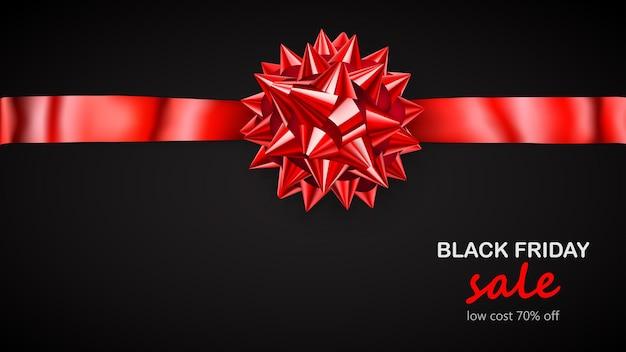 Laço vermelho com fita horizontal com sombra e inscrição venda de sexta-feira negra em fundo preto