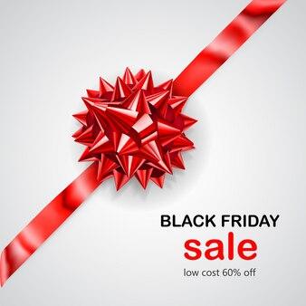 Laço vermelho com fita na diagonal com sombra e inscrição venda de sexta-feira negra em fundo branco