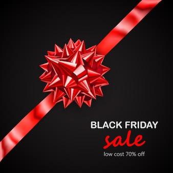 Laço vermelho com fita na diagonal com sombra e inscrição venda de sexta-feira negra em fundo preto