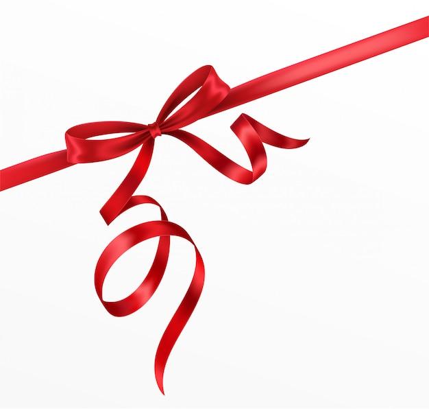 Laço vermelho e fita em fundo branco. laço vermelho realista.