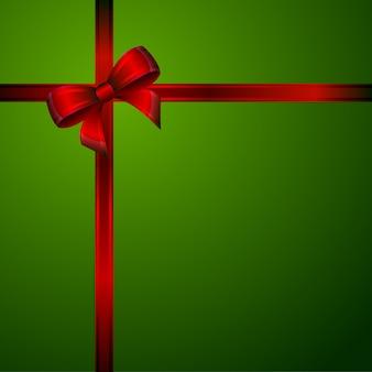 Laço vermelho sobre um fundo verde