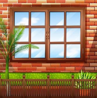 Lado do prédio com parede de tijolos e janela