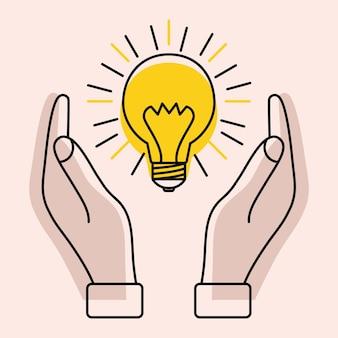 Lâmpada com raios entre as duas mãos conceito de ideias inspiração pensamento eficaz