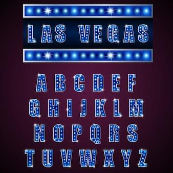 Lâmpada de alfabetos de néon claro de azul sobre fundo azul