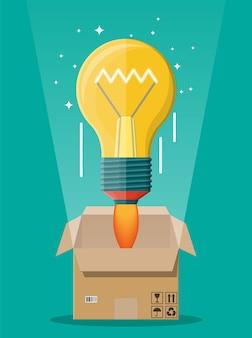 Lâmpada de ideia ejetada da caixa de papelão. conceito de inicialização, ideia criativa