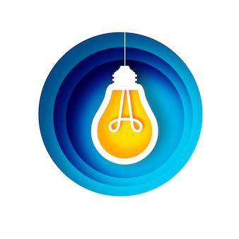 Lâmpada em estilo de papel artesanal. lâmpada elétrica de origami. cor amarela brilhante para criatividade, inicialização, brainstorming, negócios. quadro em camadas azuis do círculo. .
