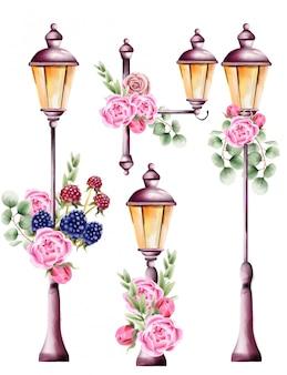 Lâmpadas da cidade decoradas com flores rosas e folhas verdes