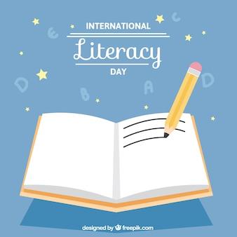 Lápis com um livro aberto para o dia de alfabetização