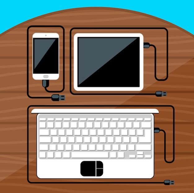 Laptop, tablet digital, smartphone com cabos usb prontos para conexão e trabalho na mesa de madeira