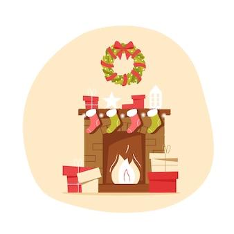 Lareira clássica de tijolos com meias de natal e uma coroa de flores em um fundo neutro