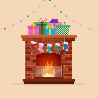 Lareira de natal com enfeites de meias e árvore de natal. feliz natal.