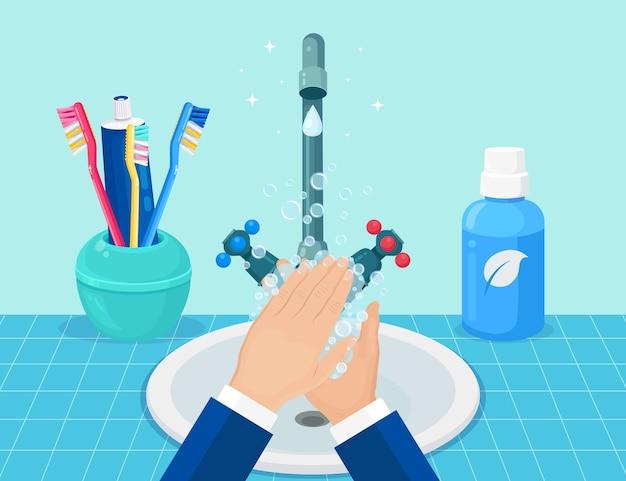 Lavar as mãos com sabonete na pia. conceito de higiene pessoal.
