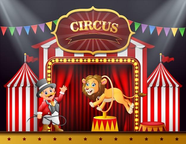 Leão dos desenhos animados, pulando através do anel na arena de palco