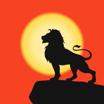 Leão em uma silhueta de rocha negra no fundo do pôr do sol no safari africano