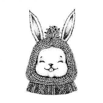 Lebre preto e branco em um chapéu e na camisola.