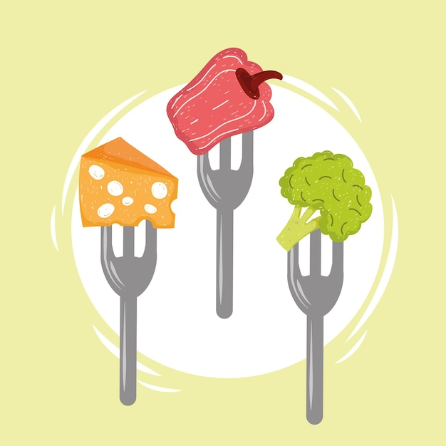 Legumes e queijo em garfos