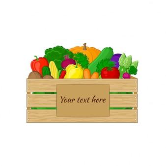 Legumes em uma caixa de madeira com placa