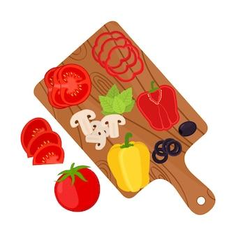 Legumes fatiados na placa de corte. ingredientes da pizza
